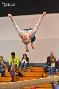 Wawasee's Taylor Busse flips from the beam during Wawasee's meet Monday night at West Noble. (Photos by Nick Goralczyk)