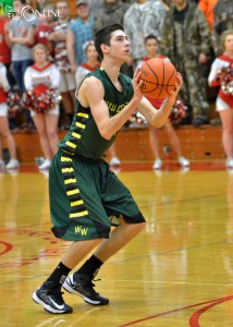 Justin Ciriello of Wawasee hoists a three at Goshen.