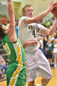 Wawasee's Alex Clark drives to the bucket against Northridge's Arick Doberenz Saturday night. (Photos by Nick Goralczyk)
