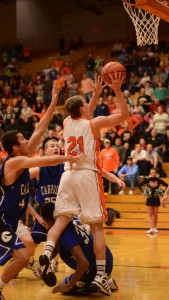 Jason Ferguson puts in the tying basket at the end of regulation for Warsaw Friday night.