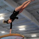 Ashleigh Frecker of Wawasee soars to a career-high on vault.