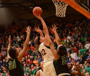 Nikki Grose of Warsaw goes up for two in the Tiger Den Saturday night in semi state play. The junior was outstanding with 20 points and 13 rebounds for the No. 8 Tigers.