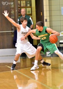 Northridge's Nate Ritchie works inside on Wawasee's Jake Hutchinson.