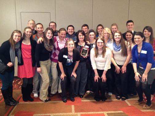 Dr. Cheryl Bremer with a group of students and a fellow professor. (Photo provided)