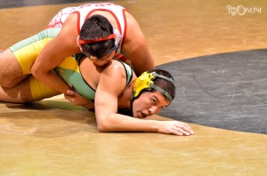Keaton Bell of Tippecanoe Valley tries to escape the hold of South Bend Adams Eder Gallegos in the first round of the Rochester Regional.