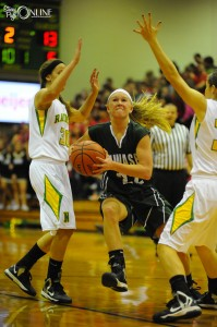 Wawasee's KiLee Knafel drives through Northridge defenders Mikaela Zook (30) and Taylor Miller Friday night at Northridge. (Photos by Mike Deak)