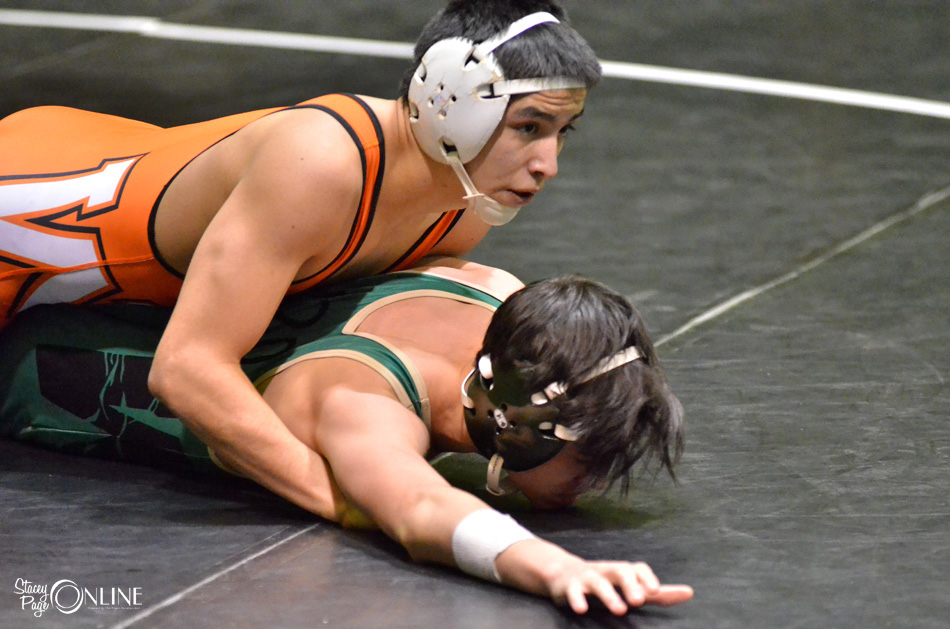 Luis Munoz of Warsaw maintains control of South Bend Washington's Justin Stephens during the semi-finals of the 120-pound class. (Photos by Nick Goralczyk)