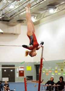 Plymouth's Cassi Quissell twists through her dismount from the uneven bars.