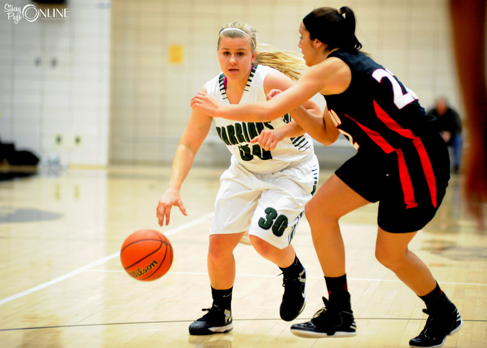 Wawasee's Kylee Rostochak looks to drive past NorthWood's Savannah Bly during the first game of the NorthWood Girls Basketball Sectional Tuesday night. (Photos by Mike Deak)