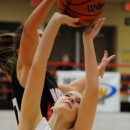 NorthWood's Jordyn Frantz blocks the shot attempt of Wawasee's Erin Wiktorowski.