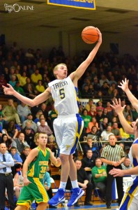Triton's Clay Yeo skies for a rebound.