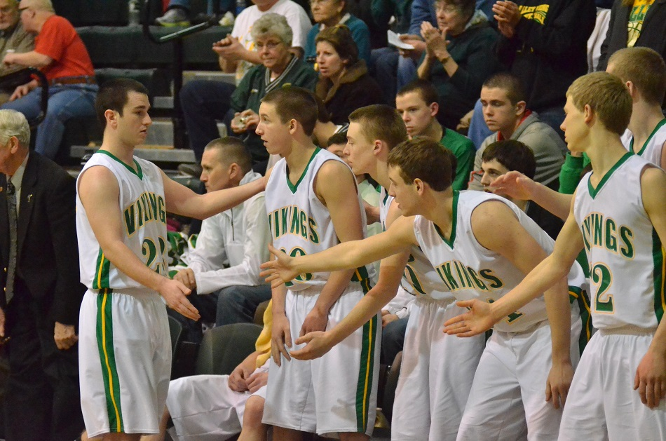 Friday's leading scorer, Nick Kindig gets a warm reception from his teammates towards the end of Friday's game.