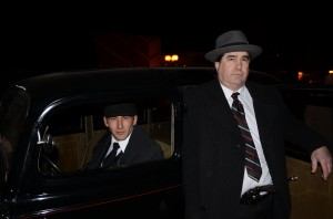 Joe Taylor was the get-away driver and Jay Jacobs portrayed John Dillinger in Friday night's re-enactment of Dillinger's 1934 heist in Warsaw. (Photo by Stacey Page)