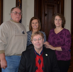 Kosciusko County Republicans held a re-organization meeting this morning. Randy Girod, seated, was elected to his second consecutive term as party chairman. Also elected was Steve Foster, treasurer; Christy Polk, secretary; and Marsha McSherry, vice chair. (Photo by Stacey Page)