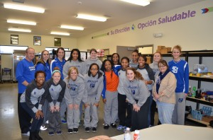 Members and coaches of Shorter University from Rome, Ga., helped stock the CCS Food Pantry. (Photo by Stacey Page)