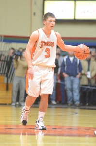 Senior Jared Bloom brings the ball up the floor versus Concord. Bloom led the Tigers with 14 points in their triple overtime win in the sectional semifinal.