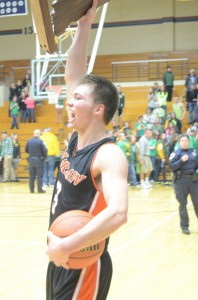 Warsaw's Jared Bloom raises the sectional championship trophy in celebration Saturday night (Photos by Scott Davidson)