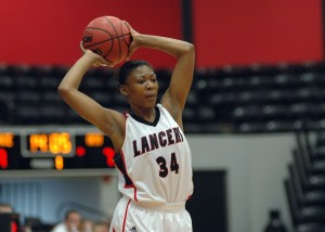 Jayla Starks of Grace looks to pass the ball Thursday night versus Oakland City.