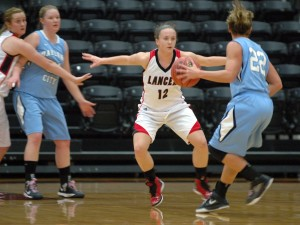 Kelsey Sule defends for Grace College Thursday night in the OCC.