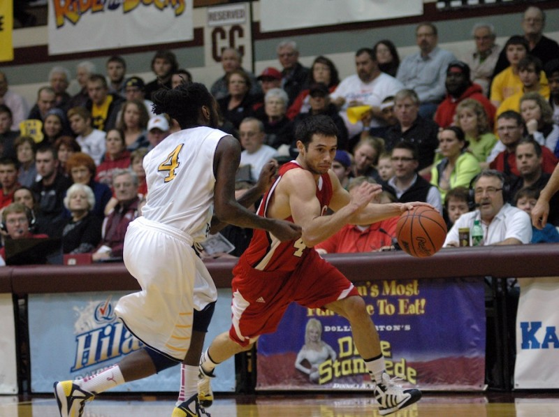 Grace College senior guard Bruce Grimm Jr. drives past a defender during action Monday night. The Lancers lost 79-58 to No. 1 William Penn in a semifinal game of the NAIA National Championships (Photo provided by Grace College Sports Information Department)