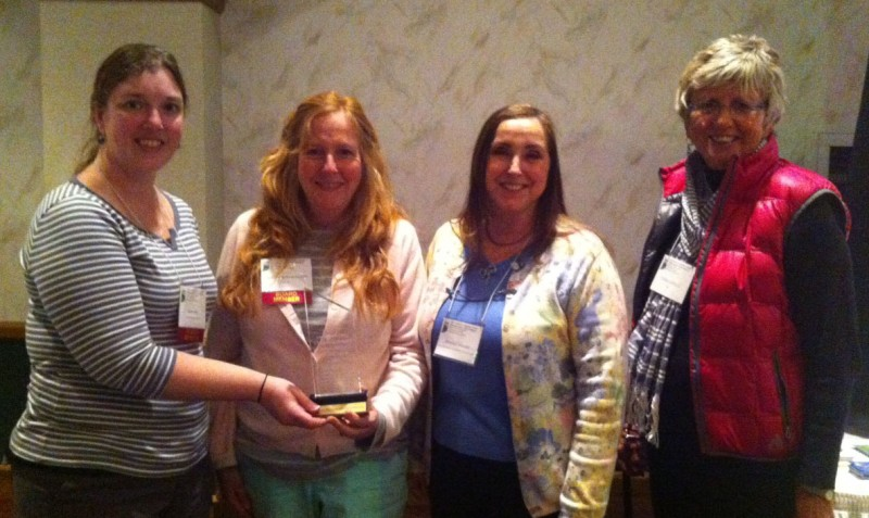 Indiana Lakes Management Society President Sara Peel, left, presents the 2013 Outstanding Lake/Watershed Association of the Year Award to, from left, Heather Hardwood, Joanne Moore, WACF Ecology Committee and Diana Castell, board member, at the annual ILMS Annual conference. (Photo provided)