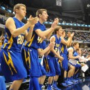 The Triton bench applauds a Trojan basket.