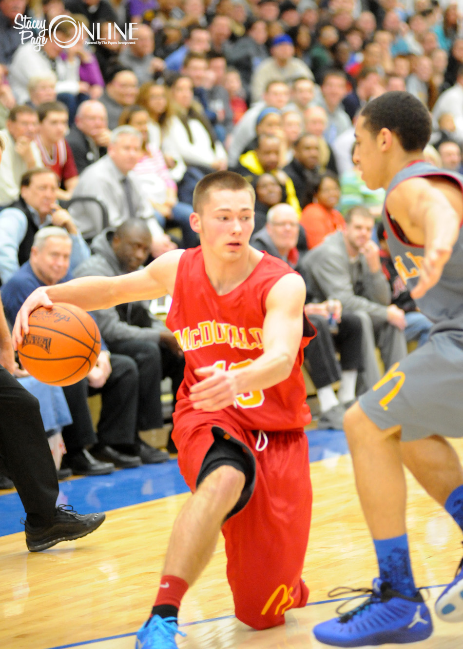 Warsaw's Jared Bloom goes past a defender Monday night during the McDonald's Michiana All-Star Game at Bethel College. Bloom scored 15 points to help his Red Team to a 140-122 win (Photos by Mike Deak)
