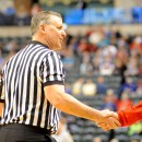 North Manchester resident Brett Patrick shakes hands with Borden head coach Doc Nash before the start of the 1-A championship game.