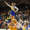 The Triton cheerleaders work over the huge sea of blue and yellow.