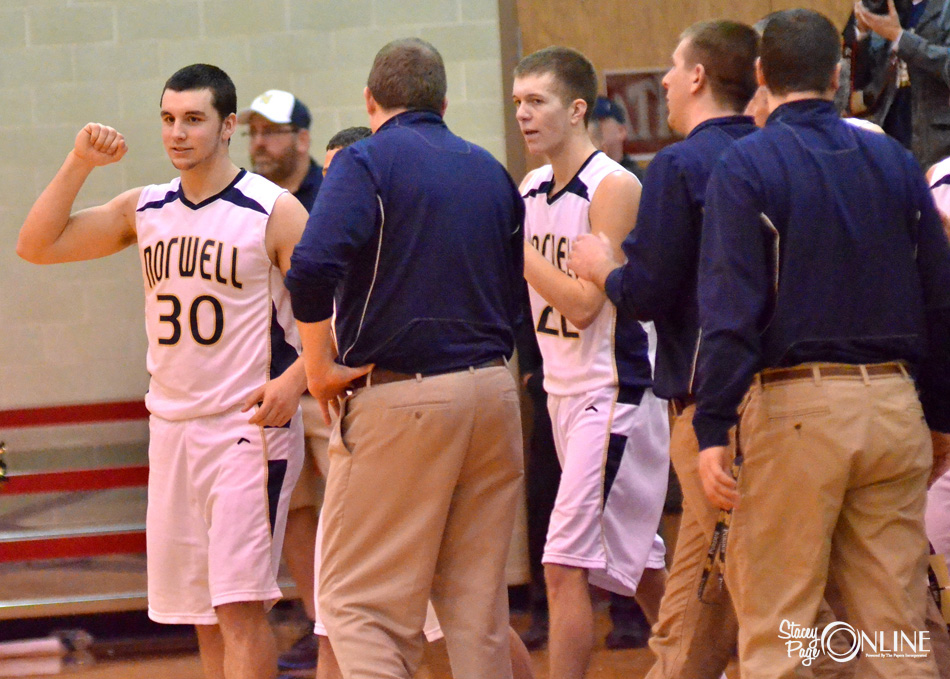 Norwell's Piercen Harnish (30) and David Vogel (22) lead the Knights off the bench after knocking Tippecanoe Valley from the Blackford Regional.