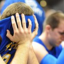 Cody Shively (near) and Drew Mosson come to grips with the end result of Saturday's championship loss.