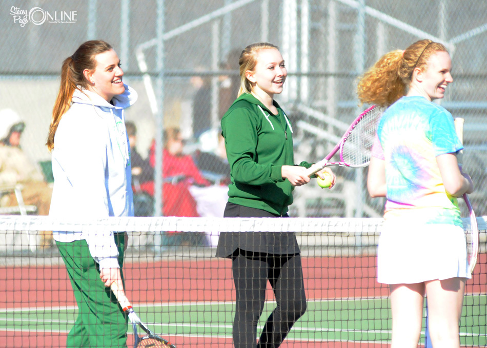 Wawasee one doubles partners Natalie Fritz (left) and Molly Smith share a laugh with Central Noble's Madeline Fair just before their opening match Thursday afternoon. (Photo by Mike Deak)