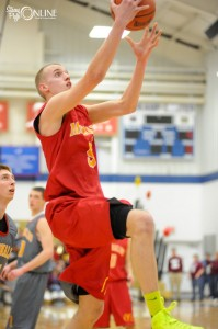 Triton star Clay Yeo flies in for two of his 23 points Monday night in All-Star action at Bethel College.