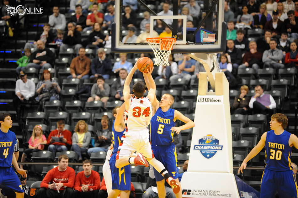 Clay Yeo blocks the shot of Borden forward Cody Bachman during the first half of the IHSAA Class 1-A Boys Basketball State Championship. (Photos by Mike Deak)