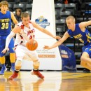 Clay Yeo and Garrett Vick scramble for a loose ball.