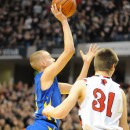Clay Yeo dives in for a basket past defender Michael Lynch.