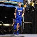 Clay Yeo leads the Trojans onto the court.