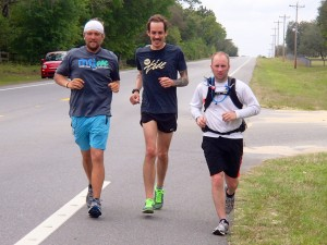Tommy Danger works through the final 100 miles with friends John Burkett, center, and Rob Lykins.