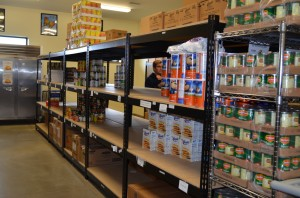 Prior to today's food drive by Lakeland Christian Academy, the food pantry at Combined Community Services was looking pretty bare. (Photo by Stacey Page)