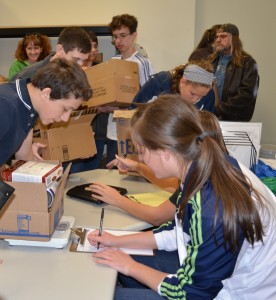 Students of Lakeland Christian Academy worked hard Wednesday during the school's fifth annual food drive for Combined Community Services. (Photo by Stacey Page)