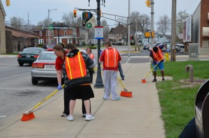 Special Education students from Warsaw Community High School and Gateway Education donated their time and efforts to help with spring cleaning along downtown walkways. (photo provided)