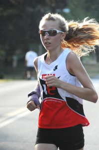 Maddie Woods motors to a championship run in the women's 8-mile run at the 2012 Flotilla Road Race. (Photo by Mike Deak)