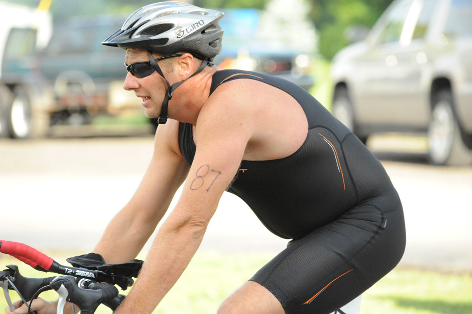 Roland Ousley bikes during the second leg of the 2012 Wawasee Triathlon. (Photo by Mike Deak)