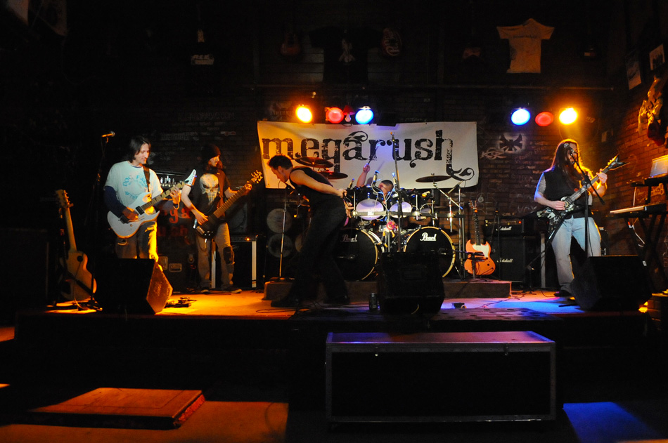 Megarush, whom hail from Mishawaka, play at Cheer's Pub in South Bend last weekend. (Photos by Mike Deak)