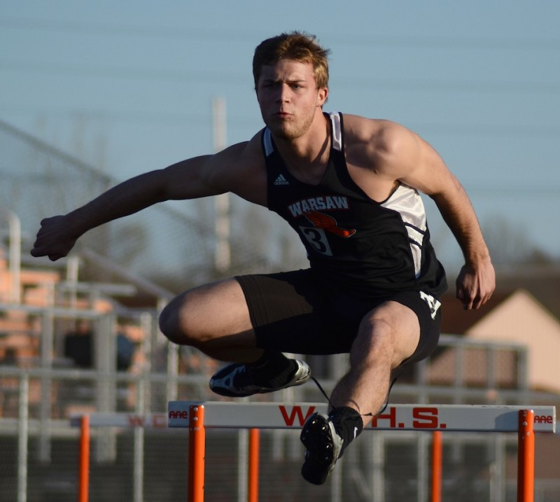 Taylor Cone competes earlier this week for Warsaw. Cone and the Tigers look to repeat as champions Friday night.