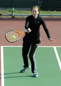 Marley Smith of Warsaw returns a shot during the one doubles match.