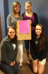 Lakeland Christian Academy students are gearing up for the 5th annual CCS Food Drive. Kneeling in front are Johanna Bramlett, left, and Jessica Hand. Standing are Ali Slabaugh, left, and Emily Daniels. (Photo by Stacey Page)