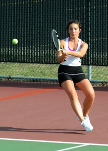 Warsaw's Jacqueline Sasso rips during two singles play.