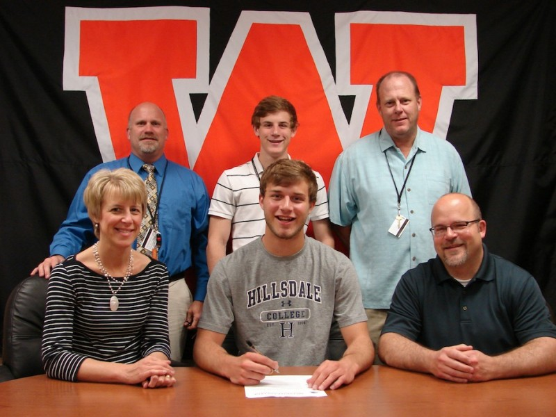 Warsaw senior Taylor Cone is headed to play football at Hillsdale College. Cone is shown above in the middle of the front row flanked by his parents Mary and Kip. In back are WCHS Athletic Director Dave Anson, Lucas Cone and WCHS football coach Phi Jensen (Photo provided)