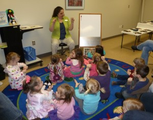 Youth Services Librarian Pam Long (aka Mrs. Pam) leads the children in a finger play at last winter's Preschool Story Time. Registration for the summer session of Preschool Story Time begins Tuesday, May 28. (Photo provided)